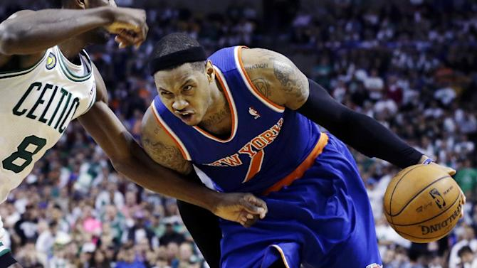 New York Knicks forward Carmelo Anthony (7) drives against Boston Celtics forward Jeff Green (8) during the second half in Game 4 of a first-round NBA basketball playoff series in Boston, Sunday, April 28, 2013. The Celtics won 97-90 in overtime. (AP Photo/Elise Amendola)