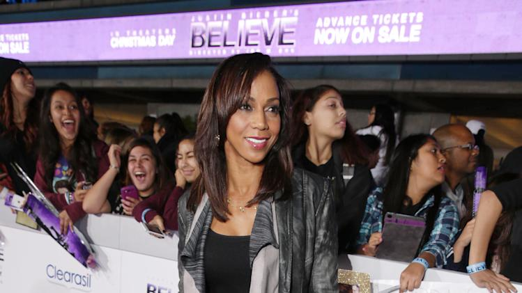 "Holly Robinson Peete seen at the World Premiere of Open Road's ""Justin Bieber's Believe"" presented by Teen Vogue and sponsored by Clearasil, on Wednesday, Dec. 18, 2013 in Los Angeles. (Photo by Eric Charbonneau/Invision for Open Road Films/AP Images)"