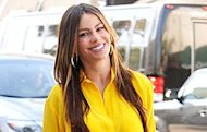 Sofia Vergara brings a little sunshine in a bright yellow button down and ripped jeans