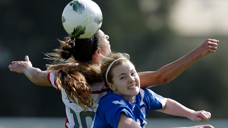 Carli Lloyd, left, of the US fights for the ball with Iceland's Glodis Perla Viggosdottir during their Algarve Cup  women's soccer match Wednesday, March 6, 2013, in Albufeira, southern Portugal. (AP Photo/Armando Franca)