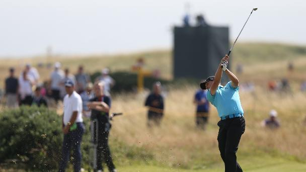 Sergio Garcia of Spain plays a shot on the 8th fairway during the final round of the British Open Golf championship at the Royal Liverpool golf club, Hoylake, England, Sunday July 20, 2014