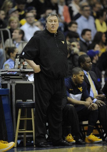 West Virginia head coach Bob Huggins looks on during the first half of an NCAA college NIT tournament first round basketball game against Georgetown, Tuesday, March 18, 2014, in Washington