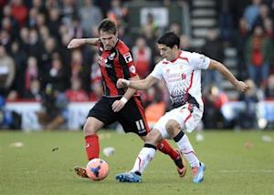 Liverpool's Luis Suarez (R) challenges Bournemouth's Charlie Daniels during their English FA Cup soccer at Dean Court in Bournemouth, southern England January 25, 2014. REUTERS/Dylan Martinez