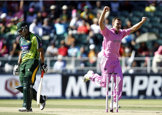 South Africa's Ryan McLaren celebrates the dismissal of Pakistan's Akmal Kamran who was caught out by AB de Villiers during their third One Day International (ODI) cricket match in Johannesburg