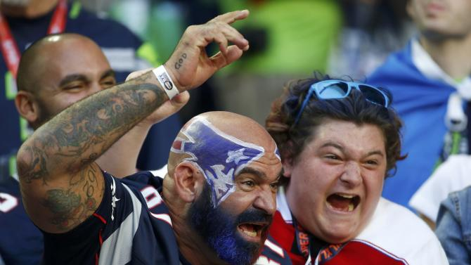 New England Patriots fans cheer ahead of the start of the NFL Super Bowl XLIX football game against the Seattle Seahawks in Glendale
