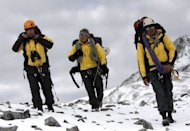 A Peruvian police high mountain rescue team walks Friday in the Hualla Hualla area during the ongoing rescue operations to locate the wreckage of a Sikorsky S-58ET helicopter lost in a southern Andean area of Peru