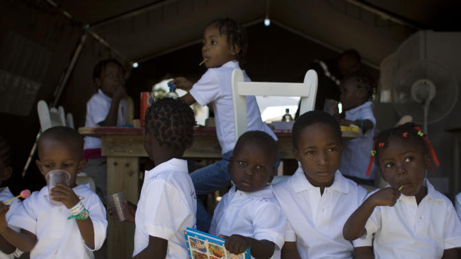 FILE - In this Dec. 21, 2010 file photo, Haitian children await the arrival of their adoptive parents in Port-au-Prince, Haiti. Haiti is overhauling its adoption laws for the first time in nearly 40 years in an attempt to end practices that have allowed thousands of children to be trafficked out of the country or suffer from neglect as they languish in squalid orphanages. (AP Photo/Ramon Espinosa, File)