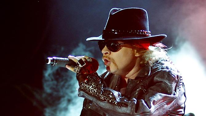 "FILE - This Dec. 7, 2012 file photo shows Axl Rose, lead vocalist of Guns N' Roses performing during their concert in Bangalore, India. A judge on Wednesday Feb. 20, 2013 dismissed Rose's lawsuit against Activision Blizzard Inc. The Guns N' Roses rocker had claimed the gaming giant violated an agreement not to feature guitarist Slash in a ""Guitar Hero"" video game. (AP Photo/Aijaz Rahi, file)"