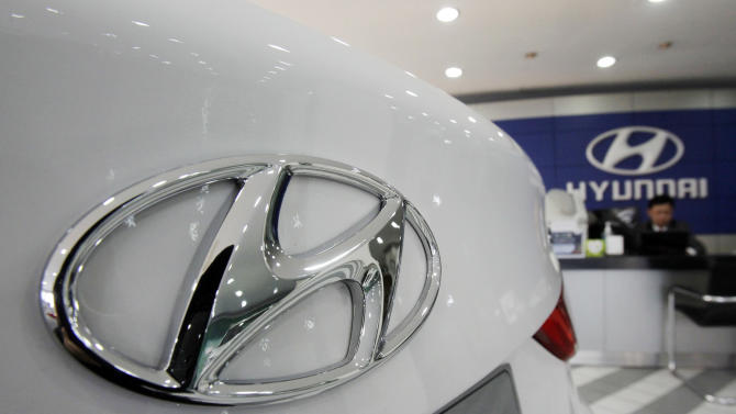 The logo of Hyundai Motor Co is seen on a car displayed at a showroom in Seoul, South Korea, Thursday, Jan. 26, 2012. Hyundai Motor Co. said its 2011 earnings reached a record high on increased demand at home and abroad. (AP Photo/Ahnn Young-joon)
