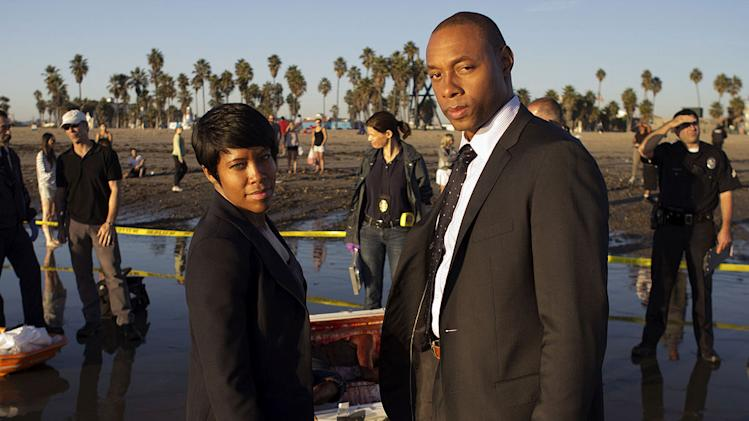 "Regina King as Detective Lydia Adams and Dorian Missick as Ruben Robinson in ""Southland."""