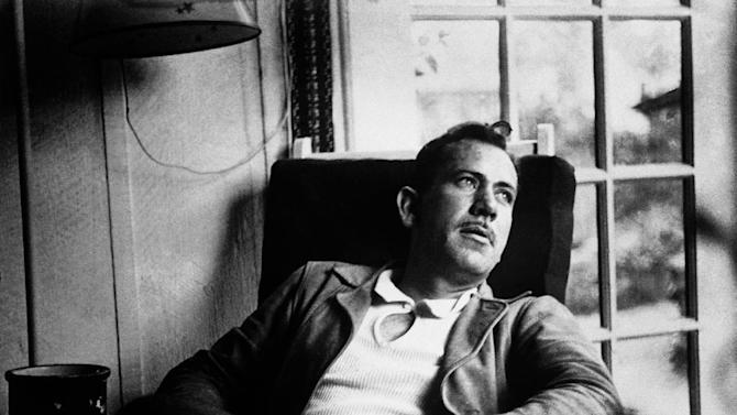"FILE - In an undated file photo, American author John Steinbeck, takes a rest from work on a new novel. A rare Steinbeck WWII story titled ""With Your Wings,"" an inspirational story about a black pilot that Steinbeck wrote for Orson Welles' radio program, and then seemed to disappear, is getting a second release. Andrew F. Gulli, managing editor of the Birmingham, Michigan-based quarterly The Strand Magazine, features it in The Strand's holiday issue, which comes out Friday, Nov. 7, 2014. (AP Photo. File)"