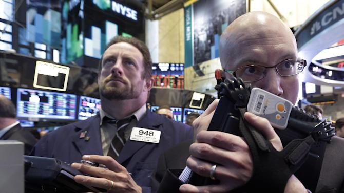 Traders Stephen Gilmartin, left, and Robert Armstrong work on the floor of the New York Stock Exchange Wednesday, April 10, 2013. Stocks are opening higher on Wall Street, a day after the Dow Jones industrial average closed at its second all-time high in a week. (AP Photo/Richard Drew)