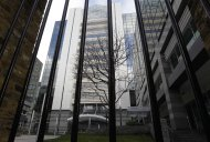 The offices of News International company headquarters in London, Saturday, Jan. 28, 2012. British police on Saturday arrested four people, including a police officer, on suspicion of corruption as part of an ongoing investigation into police bribery by the now defunct News of the World tabloid newspaper, and the police said the arrests were made as a result of information provided by Murdoch's News Corp., and officers were searching the east London headquarters of the media mogul's British newspapers for evidence. (AP Photo/Sang Tan)
