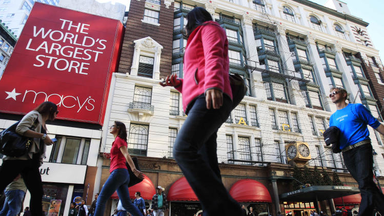 Pedestrians pass the Macy's department store location Nov. 8, 2011, in New York. Macy's Inc. is reporting Wednesday, Nov. 9, 2011, that earnings surged in the third quarter as the department store chain reaps the benefits from tailoring its merchandise to local markets (AP Photo/Frank Franklin II)