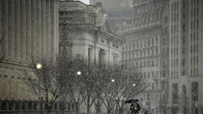 A pedestrian walks down Pennsylvania Ave near the White House in Washington, Wednesday, March 6, 2013. Schools, businesses and the federal government closed in anticipation of a snow storm that could blanket the region. (AP Photo/Pablo Martinez Monsivais)