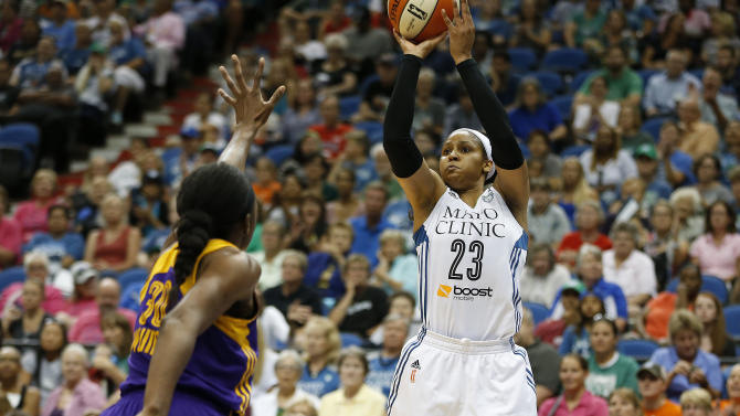 Minnesota Lynx forward Maya Moore (23) shoots the ball against Los Angeles Sparks forward Nneka Ogwumike (30) during the first half of a WNBA basketball game, Wednesday, July 29, 2015, in Minneapolis. (AP Photo/Stacy Bengs)