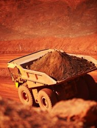 <p>Image provided by BHP Billiton shows iron ore being trucked out of the open cut mine in Western Australia. Julia Gillard's declaration came on the day that iron ore miner giant Fortescue announced it would defer planned developments.</p>