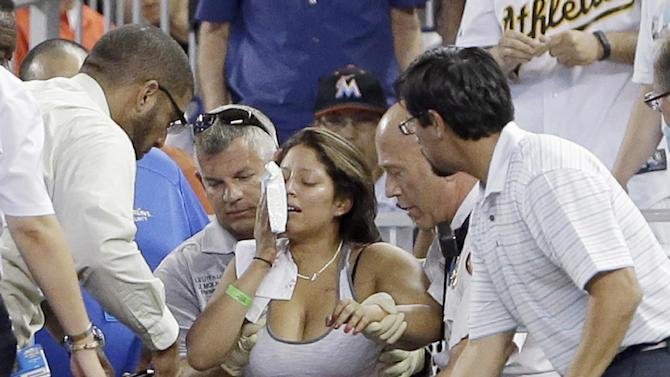 2 fans hit in face by foul at Marlins-A's game
