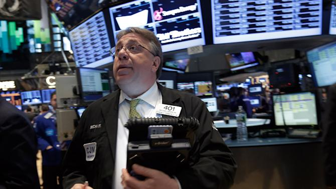 Trader Michael Iervoline works on the floor of the New York Stock Exchange Thursday, April 11, 2013.  Stock indexes are little changed in early trading on Wall Street after three days of gains. (AP Photo/Richard Drew)