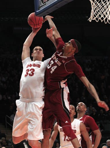 Brown scores 18, Stanford beats UMass 74-64 in NIT