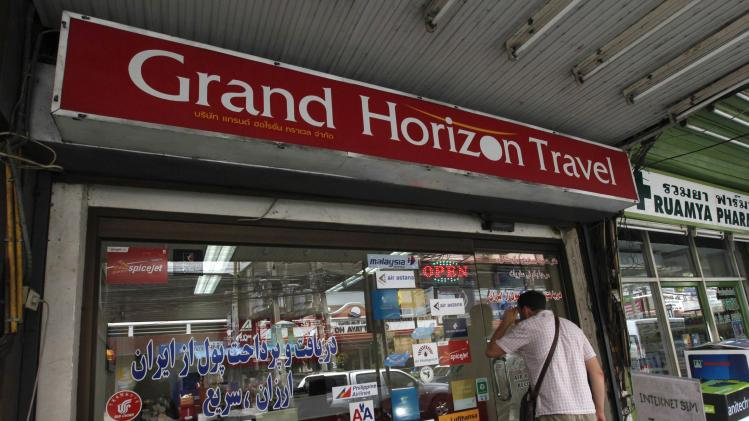 A man looks inside Grand Horizon Travel agency in the town of Pattaya