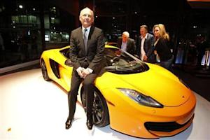 Dennis, executive chairman of McLaren Automotive, sits on a MP4-12C during the opening of the first North American McLaren Automotive dealership in Beverly Hills