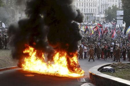 File photo of tyres set on fire during a rally held by members of far-right radical group Right Sector, representatives of Ukrainian volunteer corps and their supporters in Kiev