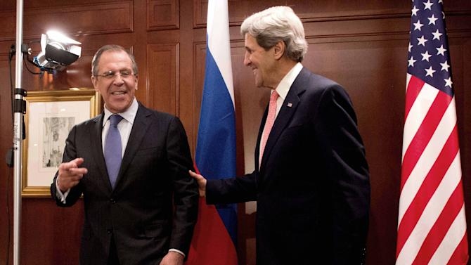 FILE - In this Feb. 26, 2013, file photo, U.S. Secretary of State John Kerry, right,  meets with Russian Foreign Minister Sergey Lavrov  in Berlin. With the smile of a seasoned politician, a flair for languages and a vast repertoire of personal anecdotes, Kerry schmoozed and cajoled his way through Europe and the Middle East on his first trip abroad as America's top envoy over the past 10 days. (AP Photo/dpa, Maurizio Gambarini)