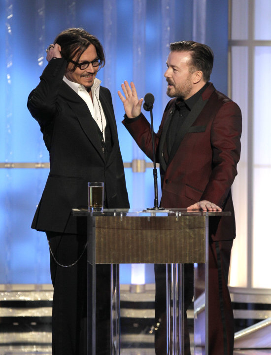In this image released by NBC, presenter Johnny Depp, left, and host Ricky Gervais are shown during the 69th Annual Golden Globe Awards on Sunday, Jan. 15, 2012 in Los Angeles. (AP Photo/NBC, Paul Dri