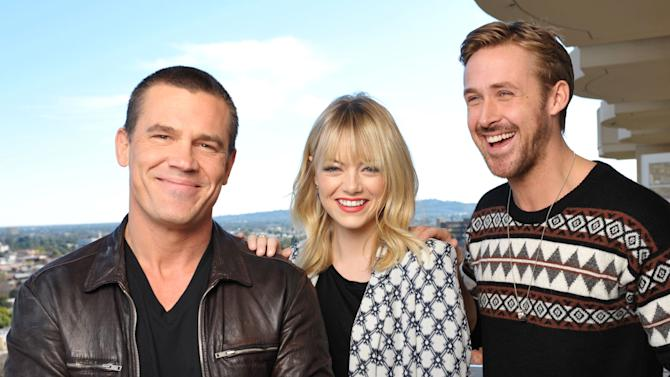 """FILE - In this Dec. 15, 2012 file photo, from left, actor Josh Brolin, actress Emma Stone, and actor Ryan Gosling from the cast of the film, """"Gangster Squad,"""" pose for a portrait at the Four Seasons Hotel, in Beverly Hills, Calif. The film releases in theaters on Friday, Jan. 11, 2013.(Photo by John Shearer/Invision/AP, File)"""