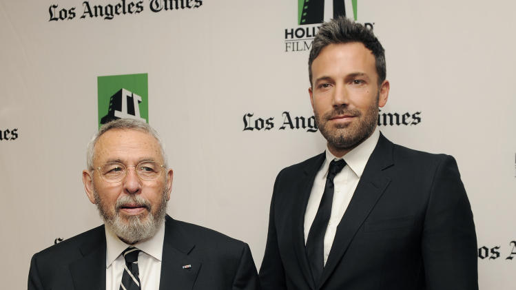 "Ben Affleck, right, a cast member and director of the film ""Argo,"" poses with former C.I.A. agent Tony Mendez, whom he portrays in the film, backstage at the 16th Annual Hollywood Film Awards Gala on Monday, Oct. 22, 2012, in Beverly Hills, Calif. (Photo by Chris Pizzello/Invision/AP)"