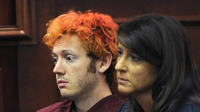 FILE - In this Monday, July 23, 2012 file photo, James Holmes, accused of killing 12 people in Friday's shooting rampage in an Aurora, Colo., movie theater, appears in Arapahoe County District Court with defense attorney Tamara Brady in Centennial, Colo.   Holmes faces two first-degree murder charges for each of the 12 people killed and two attempted first-degree murder charges for every one of the 58 injured in the July 20 shooting.   (AP Photo/Denver Post, RJ Sangosti, Pool, File)