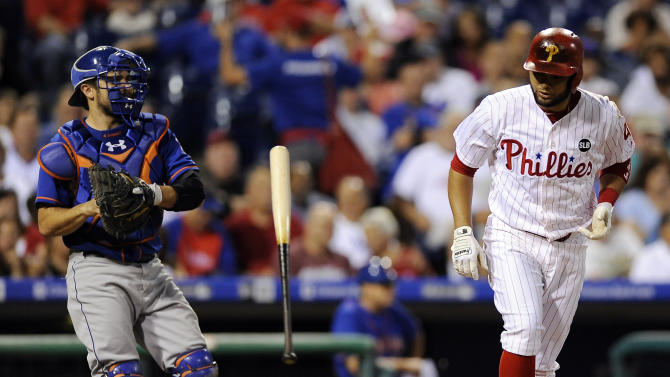 Philadelphia Phillies' Andres Blanco, right, walks as New York Mets catcher Travis d'Arnaud throws the ball back to the pitcher in the third inning of a baseball game, Thursday, Aug. 27, 2015, in Philadelphia. (AP Photo/Michael Perez)