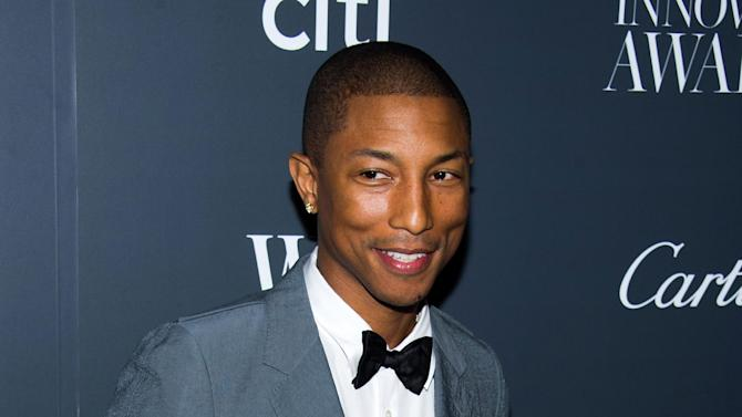 "FILE - In this Nov. 6, 2013 file photo, Pharrell Williams attends the WSJ. Magazine's Innovator Awards in New York. Williams' ""Happy,"" from the ""Despicable Me 2"" soundtrack, was nominated for an Academy Award for best original song on Thursday, Jan. 16, 2014 . The 86th Academy Awards will be held on March 2. (Photo by Charles Sykes/Invision/AP, File)"
