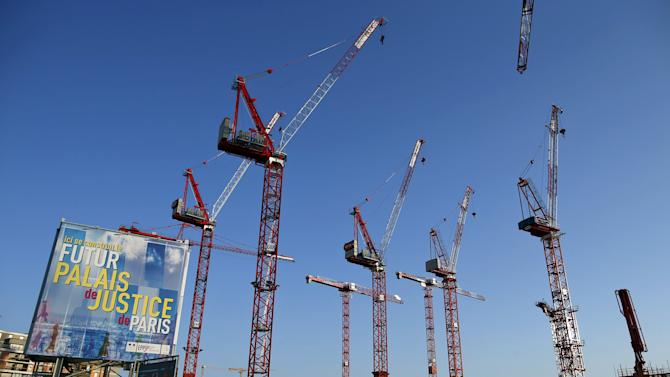 Construction cranes are seen on the building site of the new Law Court complex in Paris