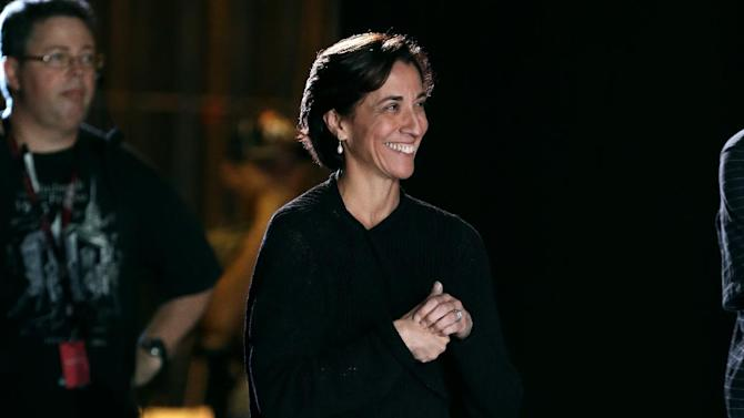 In this Thursday Oct. 18, 2012 photo, Lourdes Lopez, the new artistic director for the Miami City Ballet, watches a dress rehearsal of the Miami City Ballet from backstage in Miami. Lopez left Miami 40 years ago to pursue a career in dance. She returns to a city with a vibrant arts scene.(AP Photo/Lynne Sladky)