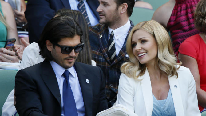 Opera singer Katherine Jenkins on Centre Court at the Wimbledon Tennis Championships in London