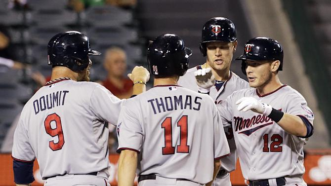 Herrmann's slam helps Twins beat Angels 10-3 in 10