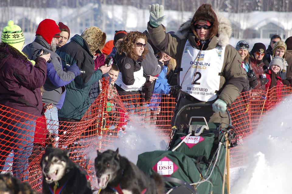 In this Sunday, March 4, 2012, photo, Ray Redington Jr. leaves as the first musher during the official start of the Iditarod Trail Sled Dog Race in Willow, Alaska. Redington was among the early leaders of the race on Monday. (AP Photo/Mary Pemberton)