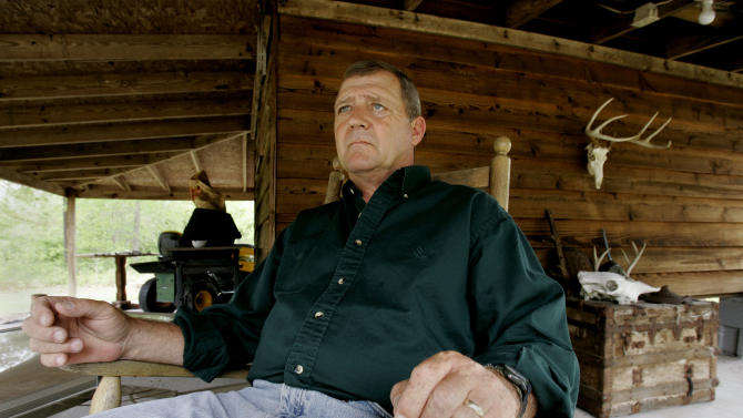 FILE - Jerry Ensminger sits on the porch of his home in White Lake, N.C. on Wednesday, May 9, 2007. The former Marine master sergeant, who lost his daughter Janey to leukemia at age 9, says her illness was caused by the contaminated water at Camp Lejeune, N.C. (AP Photo/Gerry Broome)