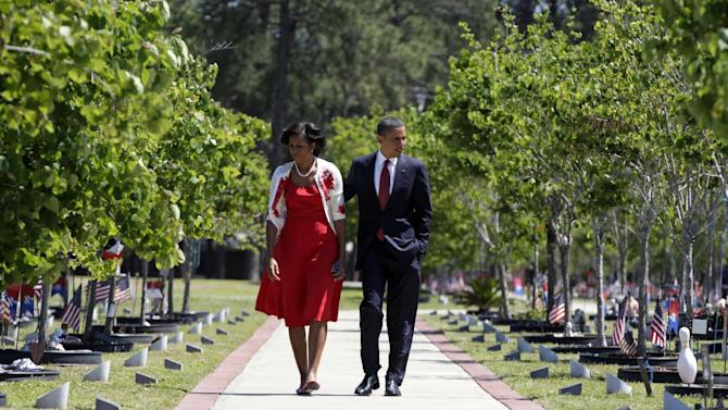 President Barack Obama and first lady Michelle Obama visit Warriors Walk at Fort Stewart, Ga., Friday, April 27, 2012, before speaking to troops, veterans and military families at the Third Infantry Division Headquarters.  (AP Photo/Carolyn Kaster)