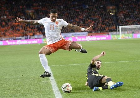 Daniel Carvajal of Spain (R) challenges Memphis Depay of the Netherlands during their international soccer friendly match at the Amsterdam Arena