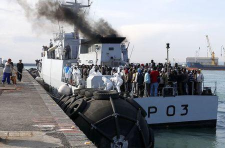 Migrants arrive at the Sicilian harbor of Catania