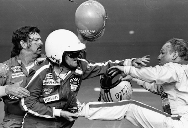 FILE - In this Feb. 18, 1979 file photo, Bobby Allison holds race