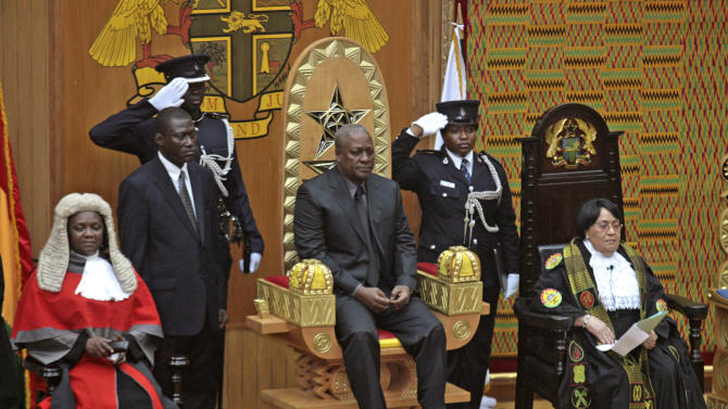 "FILE - In this Tuesday, July 24, 2012 file photo, former Vice President John Mahama, center, sits on a dais after being sworn in as new president of Ghana in parliament in Accra, Ghana after the death of President John Atta Mills. After five coups and decades of stagnation, the West African nation of 25 million is now a pacesetter for the continent's efforts to become democratic. In presidential elections on Friday, Dec. 7, 2012, a leading candidate is Mahama, who survived the coups, became president and in fall 2012 published ""My First Coup d'Etat,"" a memoir that has won international acclaim. (AP Photo/Christian Thompson)"