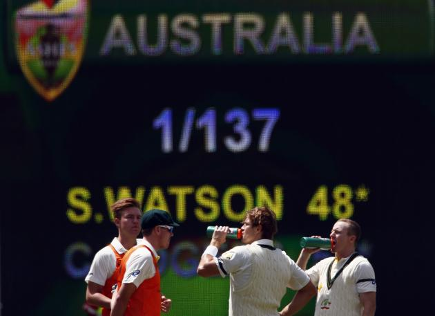 Australia's Rogers and Watson drink during a break on the first day's play in the second Ashes test against England in Adelaide