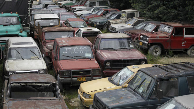 In this photo taken on June 9, 2011 are cars seized by the National Drug Office, or DNE, from Colombian drug lords in Bogota, Colombia. Two decades after it was created, President Juan Manuel Santos has decided to scrap the DNE because of the agency's mismanagement. Interior Minister German Vargas said a decree dissolving the agency would come soon, leaving the Finance Ministry to sort through a list of 95,000 assets to determine what remains and how much has been plundered and by whom. (AP Photo/Fernando Vergara)