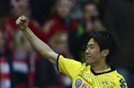 German football magazine Kicker reported Tuesday that Japan star Shinji Kagawa (pictured after scoring for Borrussia Dortmund in Berlin on May 12) is set to join English giants Manchester United for 15 million euros ($18.8 million) with the deal almost complete