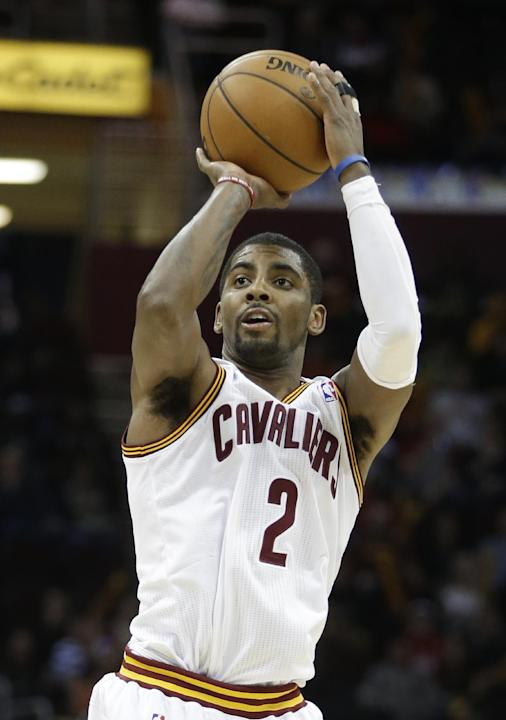 Cleveland Cavaliers' Kyrie Irving shoots a 3-point shot against the New York Knicks in there fourth quarter of an NBA basketball game Tuesday, Dec. 10, 2013, in Cleveland