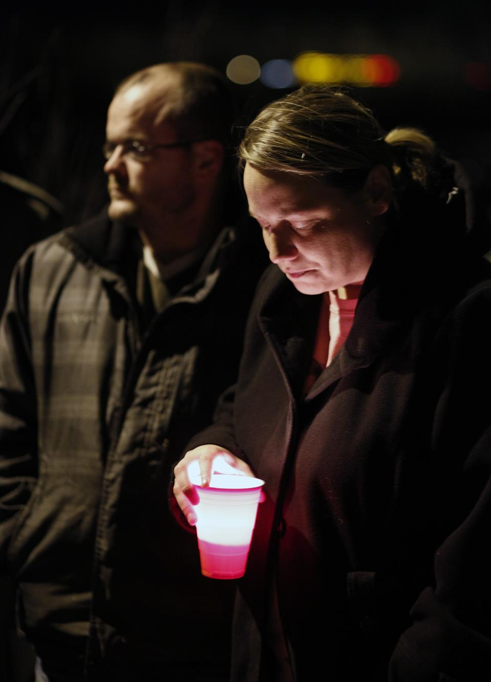 Sarah Curl family friend speaks out during a vigil held at Meyers lake Wednesday, Dec. 5, 2012, in Evansdale, Iowa.  Hunters discovered two bodies Wednesday believed to be the young Iowa cousins who vanished five months ago while riding their bikes, authorities said. (AP Photo/Waterloo Courier, Matthew Putney)
